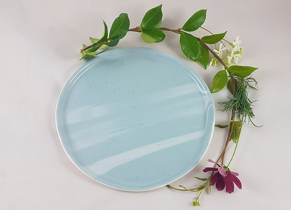 Assiette en porcelaine, variations de bleu