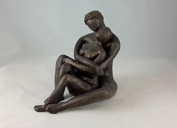 Sculpture, couple assis