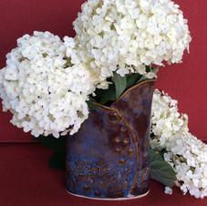 Blue vase with hydrangeas