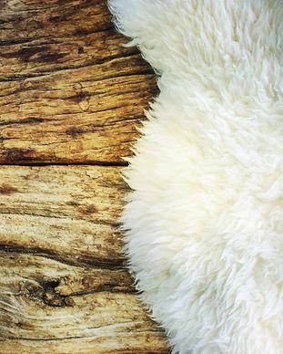 Decorative fur carpet on wood floor back