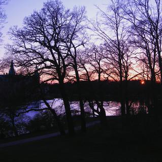 Frederiksborg Castle sunset through the