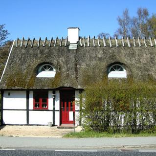 Little House along the road by Arresø la