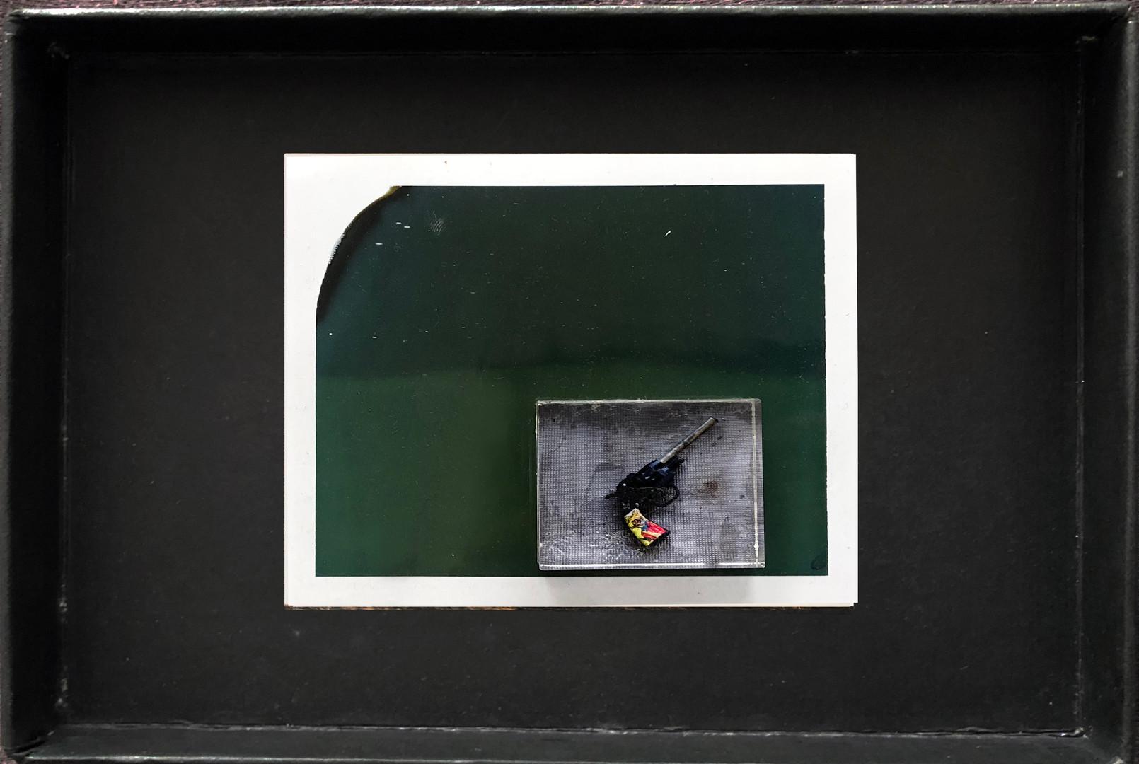 "Series X-Pola ""Jason's gun"" 2019 8/10cm mounted Plexiglass on Polaroid Edition 1/1 NIS 1,000 per object"