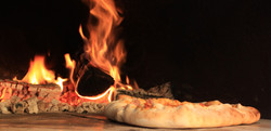 Wood fired Pizza Cooking