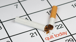 calendar with quit today marked and broken cigarette