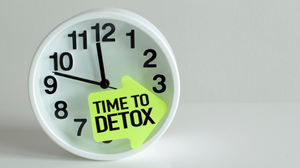 desk clock with sticker that says Time to Detox