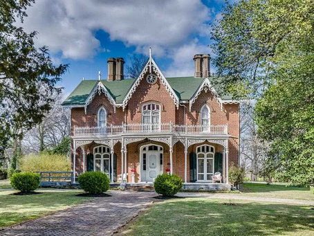 1857 French Gothic Mississippi Mansion With Red Stained Glass & 10 Acres Lists For Just $215,000