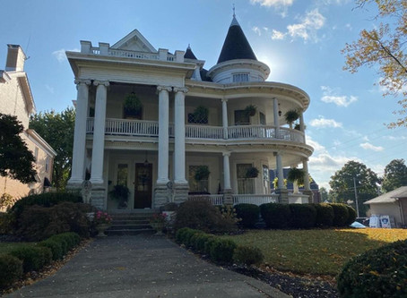Indiana Victorian With Ornate Fretwork And Reading Nook Under Grand Staircase Lists At $284,900