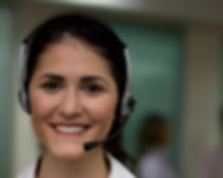 A woman in a call center wearing a telephone headset