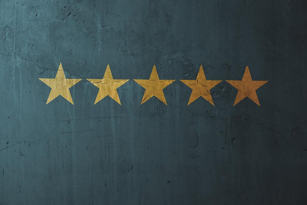 Five start icon on blue concrete wall ba
