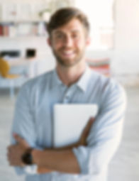 man holding tablet smiling in office