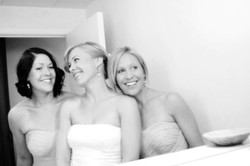 beach bride and bridesmaids smiling