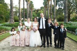 bridal party amongst palm trees