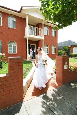 Noosa bride walking past house
