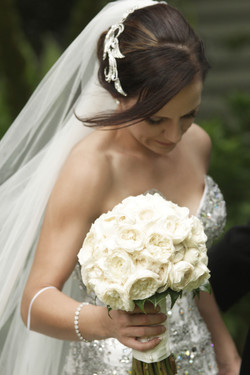 Noosa bride with white rose bouquet