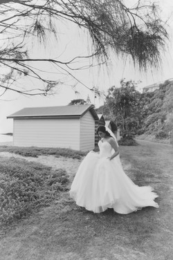 a bride walks behind a beach box