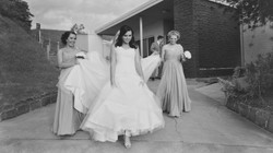 a bride and her bridesmaids walking