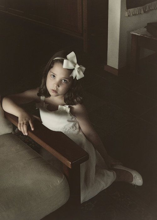 young flowergirl wearing hair bows