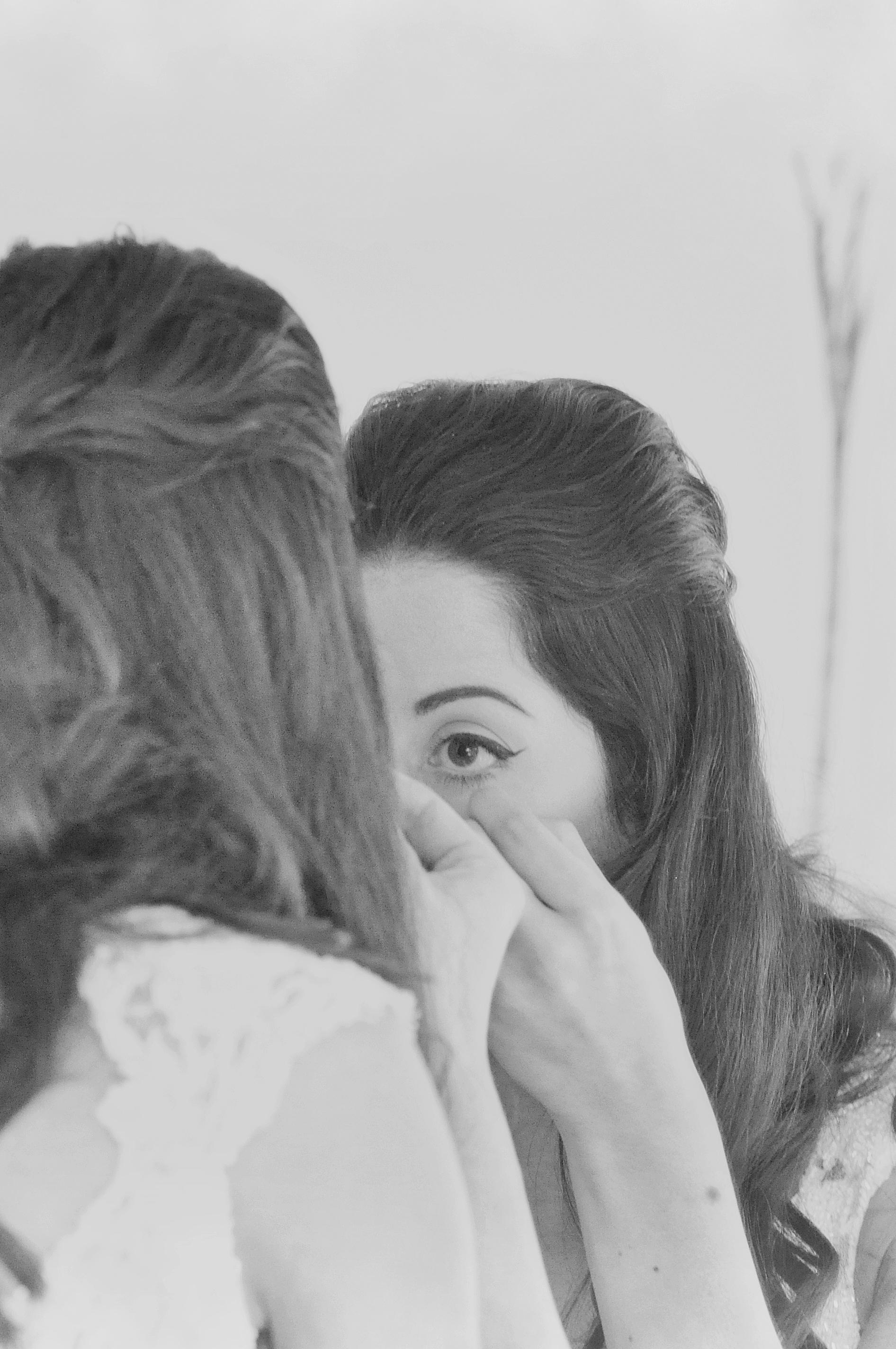 Noosa wedding bride looks in mirror
