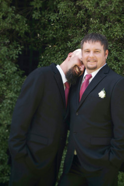 two wedding grooms cuddle