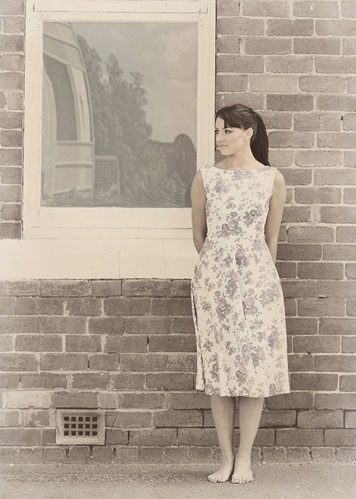 retro bridesmaid standing by window