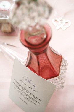pink perfume bottle and menu