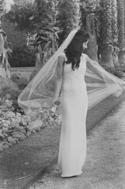 a playful wedding bride and veil