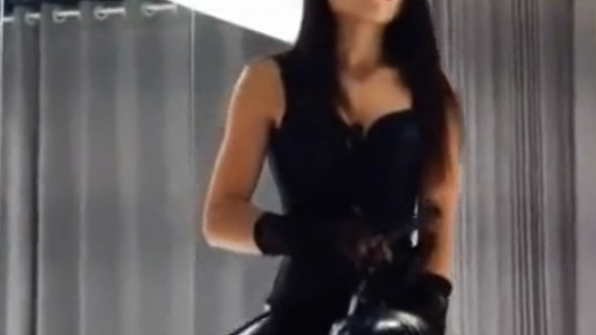 Sexy Chinese model in leather corset and her obedient sub