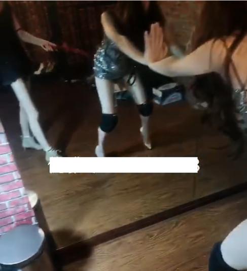 Crossdressed slave taking a beating from Goddess Youya