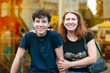 Boy of adolescence with his mother talk, laugh, have fun together all evening at sunset in