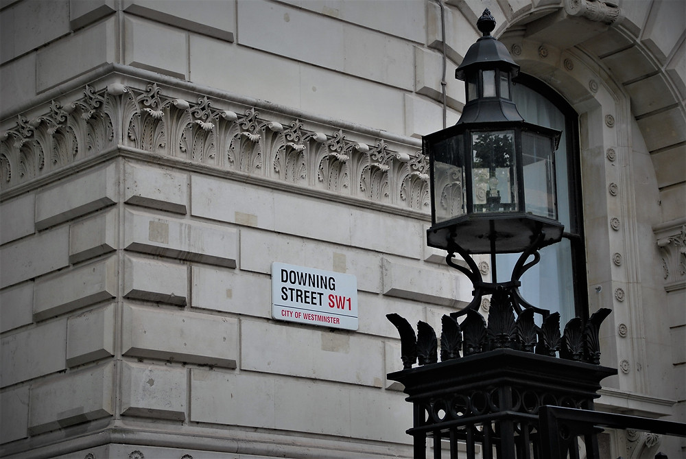 Downing street road sign where permitted development rights are changing to benefit developers
