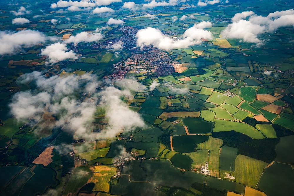 Ariel view of the UK greenbelt through clouds