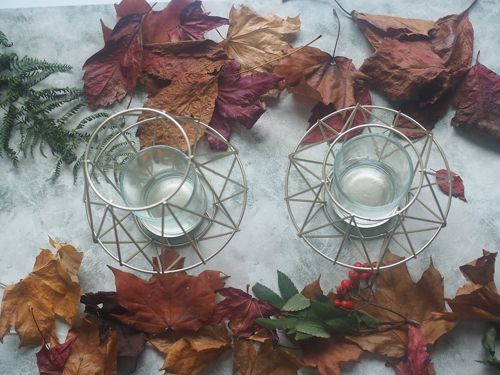 Two gold geometric candle holders