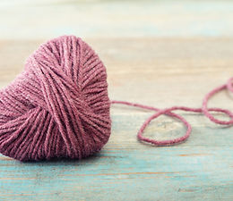 picture of a pink heart ball of yarn
