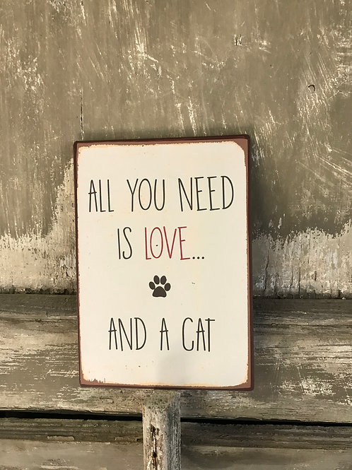 Schild: All you need is love and a cat