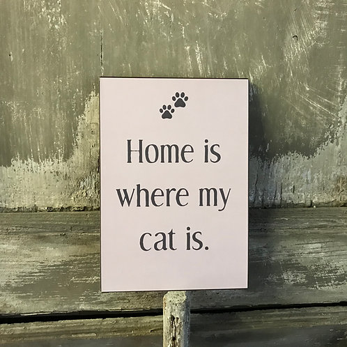Schild:  Home is where my cat is