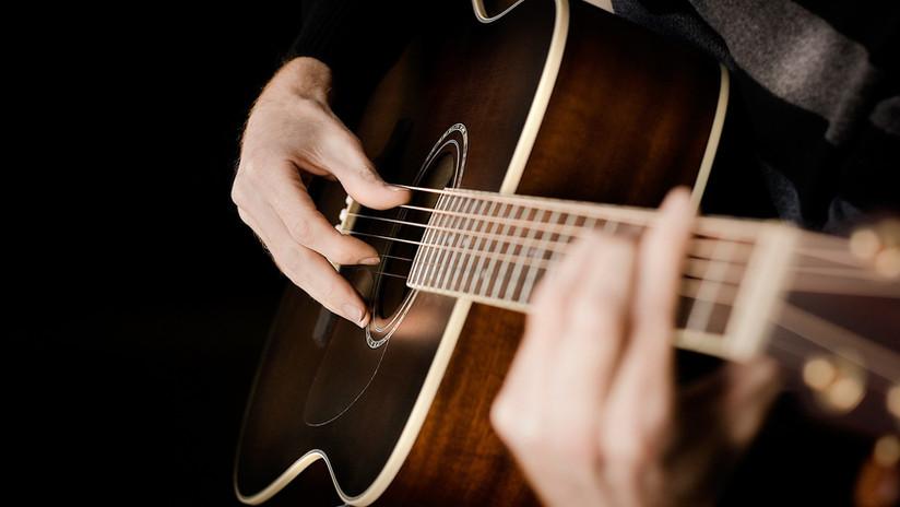 Playing-Acoustic-Guitar-Wallpaper.jpg