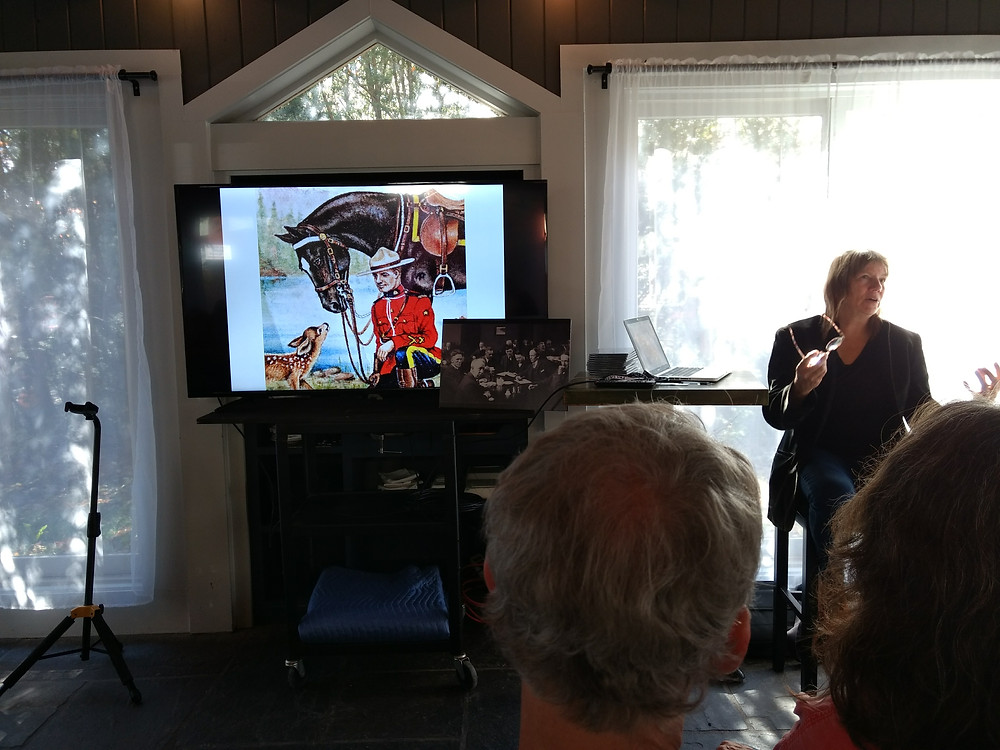 """Linda Manzer presenting the """"Group of Seven"""" guitar project."""