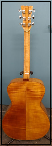 Flame Maple back with 5 piece maple/mahogany neck.