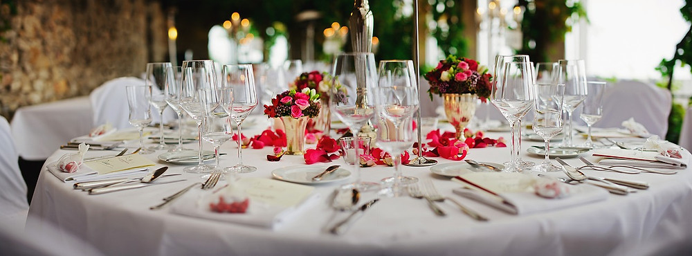 beautiful restaurant table with well decorated flowers and cutlery