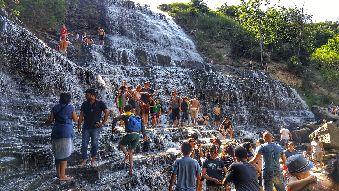 People standing along the waterfalls