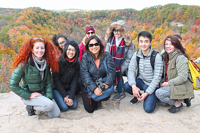 Group of people sitting on the age of dundas peak