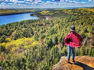 Man standig at Booth's Rock Trail in Algonquin Provincial Park