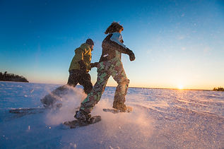 couple is snowshoeing