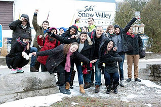 Group of people taking a pictue in front of Snow Vally, Barrie sign