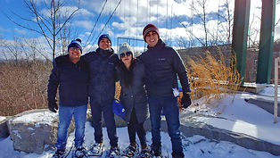 Group of people snowshoeing at Scenic Caves