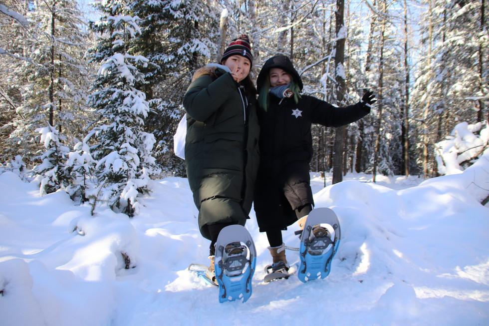 Two girls snowshoeing in north muskoka, Sundridge