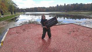 girl standing in cranberry bog in Bala