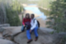 Couple is sittin on the rock at Beaver Pond Trail
