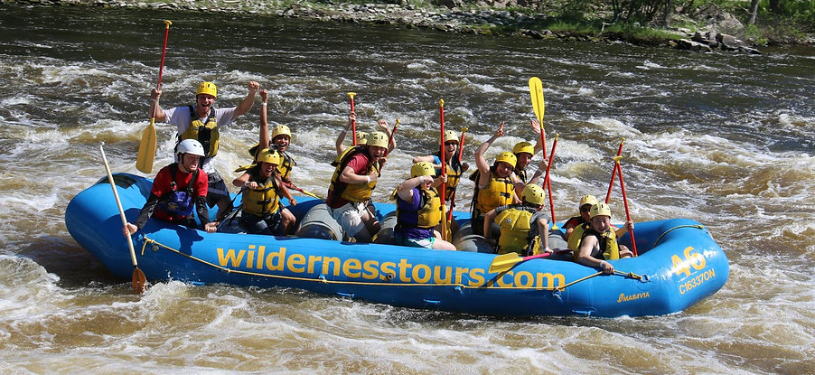 Rafters with paddles on the river